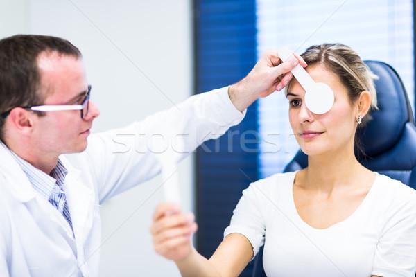 Fiatalember szemek szemorvos csinos fiatal nő nő Stock fotó © lightpoet