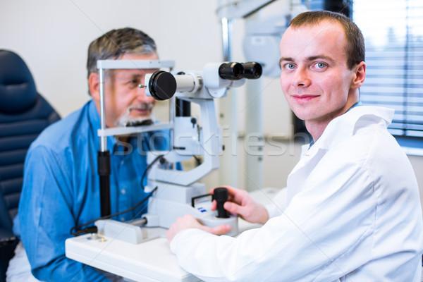Optometry concept - senior man having his eyes examined  Stock photo © lightpoet