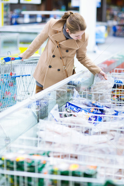 pretty youman buying groceries in a supermarket/mall/grocery Stock photo © lightpoet