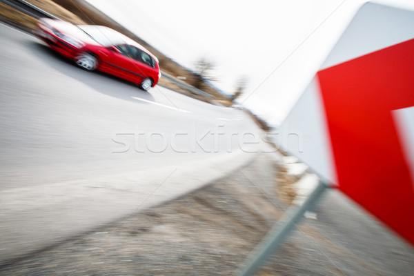 Traffic concept: car driving fast through a sharp turn  Stock photo © lightpoet