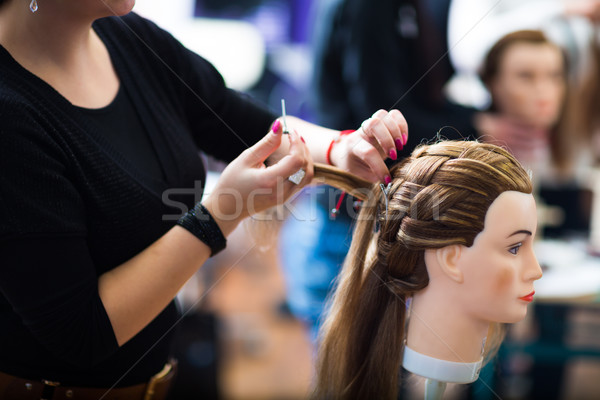 Pretty female hairdresser/haidressing apprentice/student trainin Stock photo © lightpoet