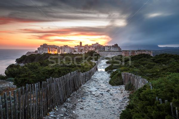 Coucher du soleil tempête vieille ville calcaire falaise Photo stock © lightpoet