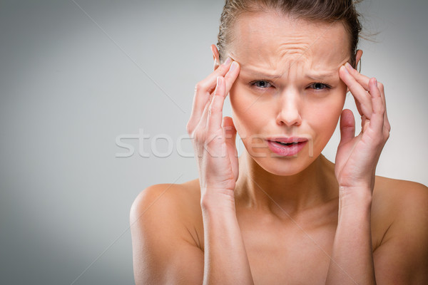 Beautiful woman suffering from acute headache  Stock photo © lightpoet