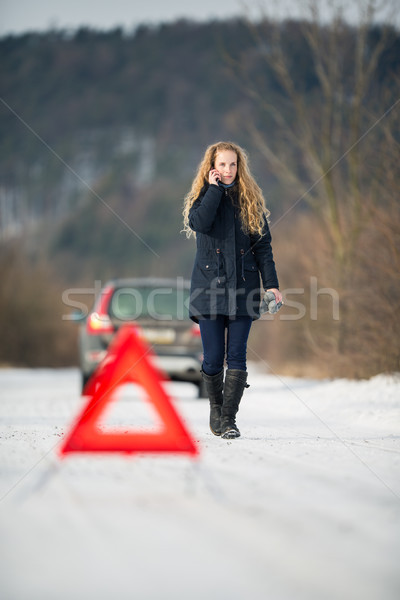 Young woman setting up a warning triangle Stock photo © lightpoet