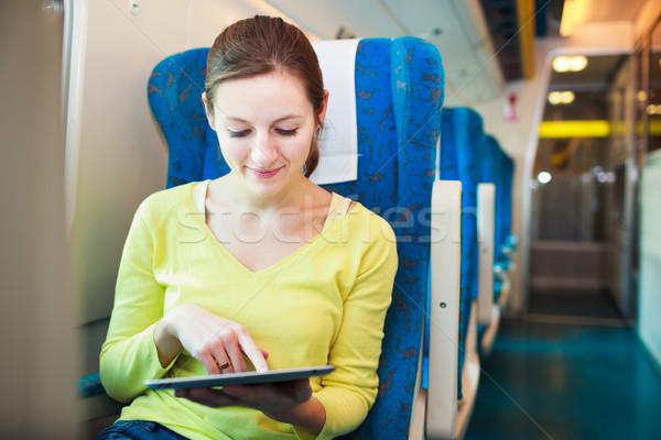 Jonge vrouw trein business computer Stockfoto © lightpoet