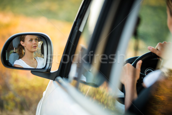 Pretty, young woman  driving her car - reflection in the side mirror Stock photo © lightpoet