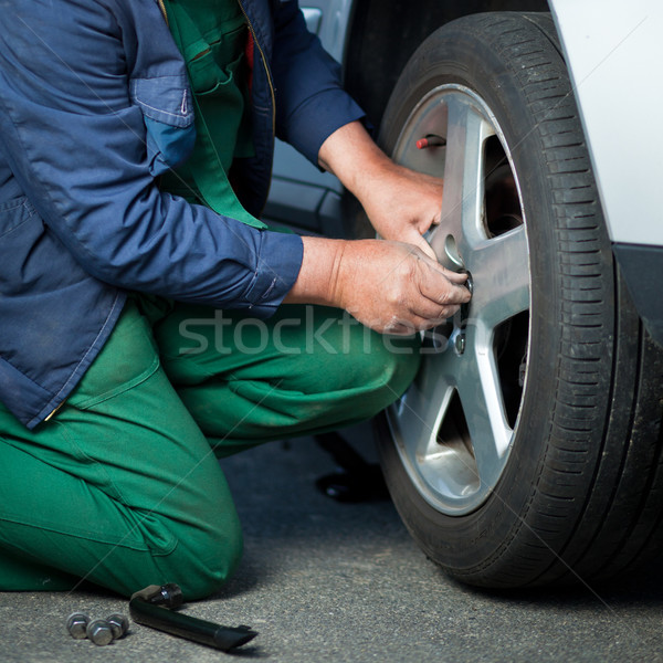 mechanic changing a wheel of a modern car  Stock photo © lightpoet