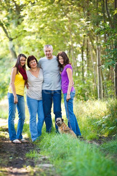 Családi portré család négy aranyos kutya kint Stock fotó © lightpoet