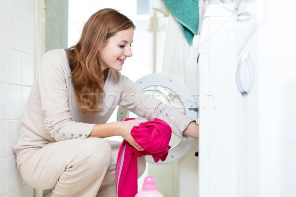 Ev işi genç kadın çamaşırhane sığ renk Stok fotoğraf © lightpoet