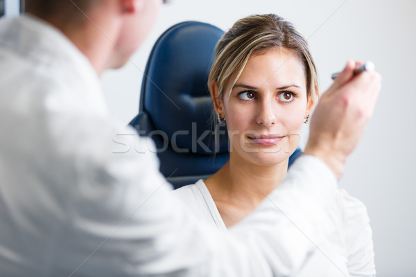 Optometry concept - pretty young woman having her eyes examined  Stock photo © lightpoet