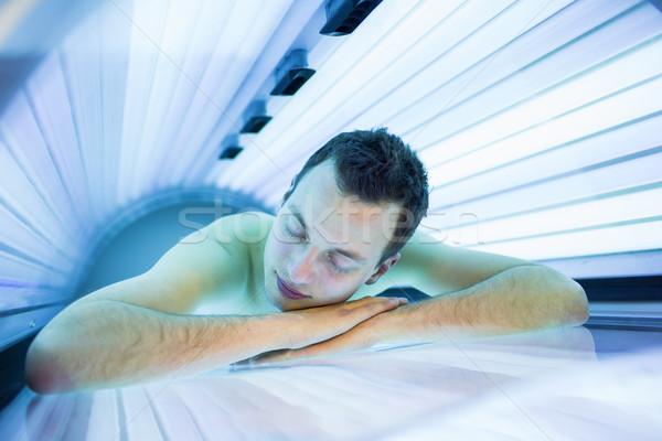 красивый молодым человеком расслабляющая современных солярий Сток-фото © lightpoet