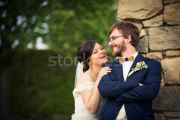 Stock photo: Portrait of a young wedding couple on their wedding day