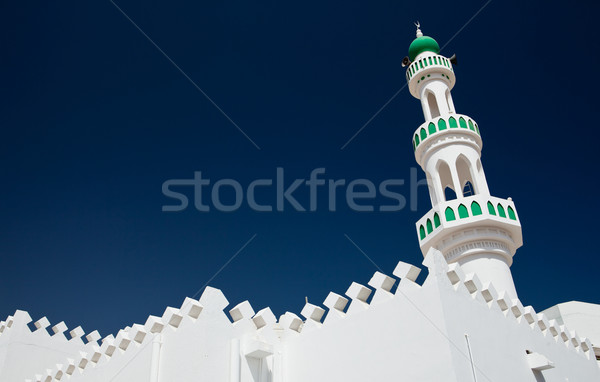White mosque with minaret against blue sky (Sur, Oman) Stock photo © lightpoet