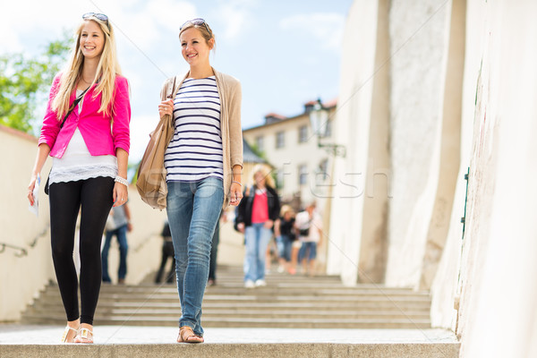 Two pretty, young women walking in the Prague historic center Stock photo © lightpoet
