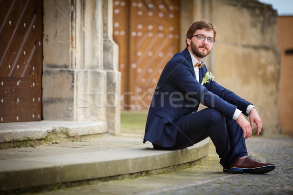 Handsome groom on his wedding day waiting for his bride Stock photo © lightpoet