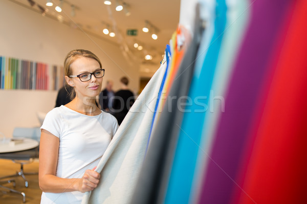 Stock photo: Pretty young woman  choosing the right material/color
