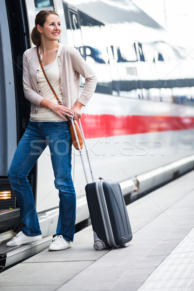 Pretty young woman boarding a train Stock fotó © lightpoet