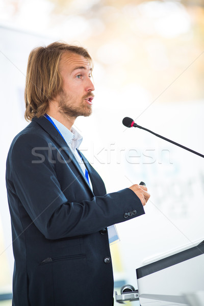 Handsome young man giving a speech at a conference Stock photo © lightpoet
