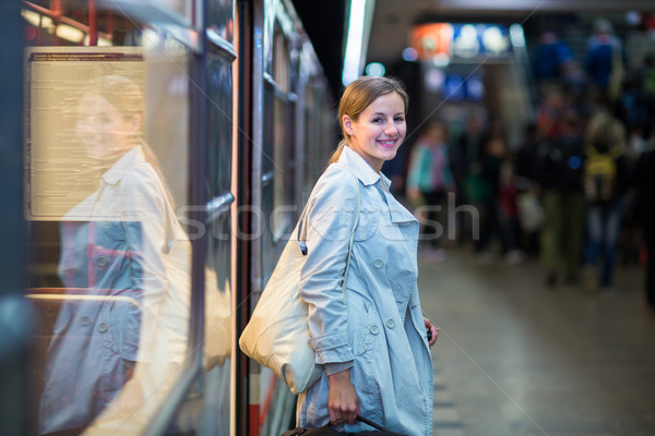 Elegant, smart, young woman taking the metro/subway Stock photo © lightpoet