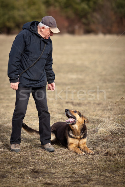 Master and his obedient (German Shepherd) dog Stock photo © lightpoet