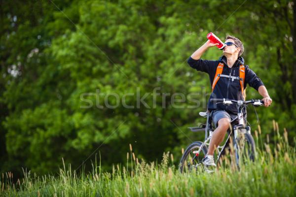 Jóképű fiatalember motorozás vidék tavasz természet Stock fotó © lightpoet