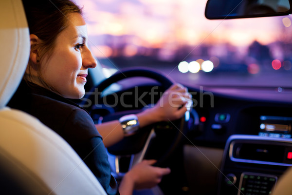 young woman driving her modern car at night in a city Stock photo © lightpoet