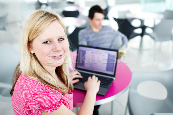 Two college students having fun studying together, using a lapto Stock photo © lightpoet