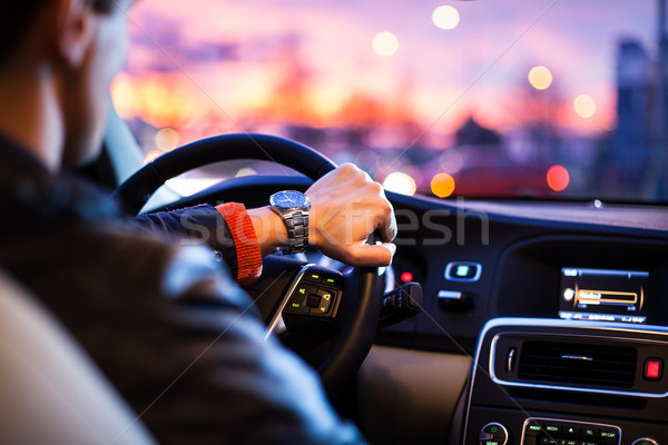 Driving a car at night -man driving his modern car at night Stock photo © lightpoet