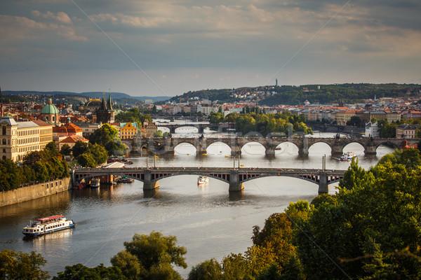 Prague with its splendid bridges over the Vltava river, city sun Stock photo © lightpoet