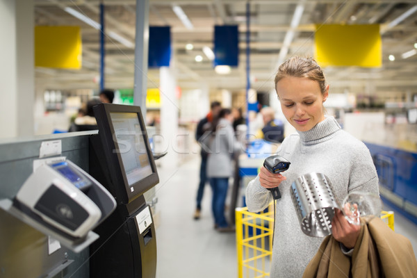 Pretty, young woman using self service checkout in a store  Stock photo © lightpoet