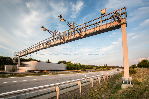 Truck passing through a toll gate on a highway (motion blurred i Stock photo © lightpoet