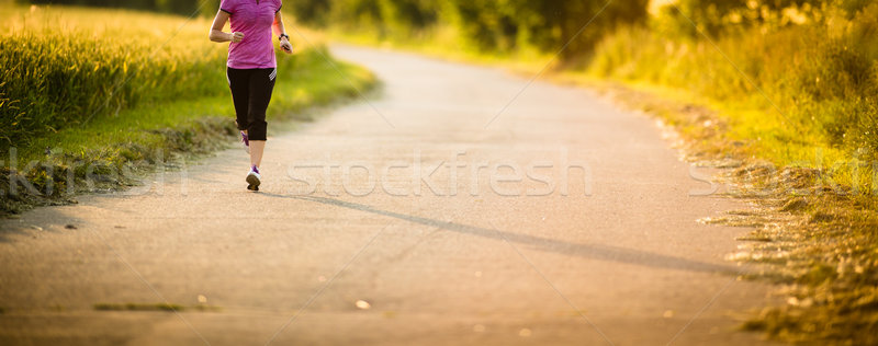 Detail of legs of a female runner on road - jog workout/well-bei Stock photo © lightpoet