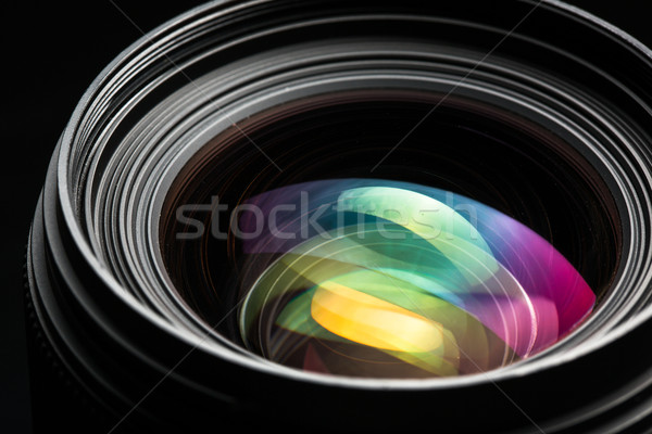 Stock photo: Professional modern DSLR camera llense low key image