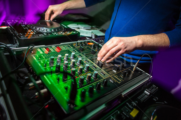 DJ's hands at the music mixer at a party - playing some fine songs Stock photo © lightpoet