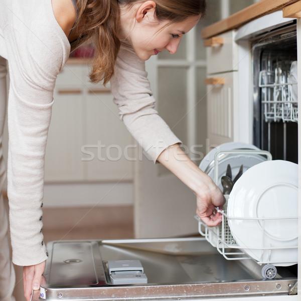 Ev işi genç kadın bulaşık bulaşık makinesi ev kız Stok fotoğraf © lightpoet