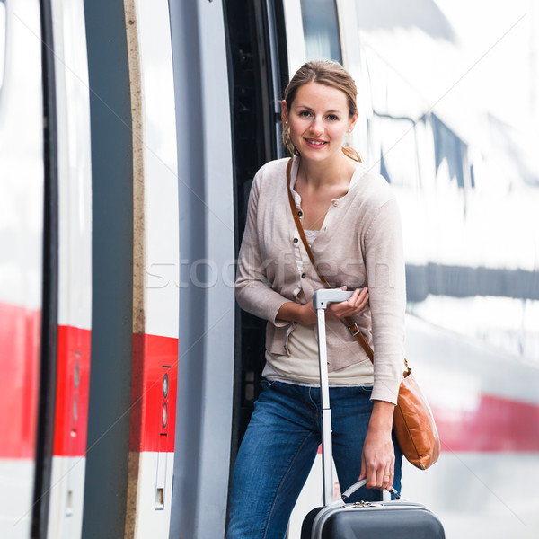 Pretty young woman boarding a train Stock photo © lightpoet