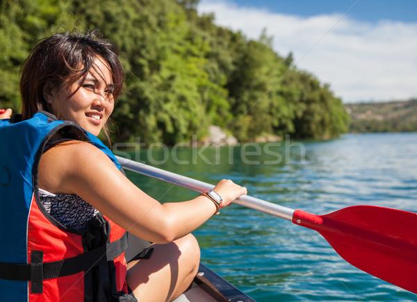 Bastante mulher jovem canoa lago verão Foto stock © lightpoet