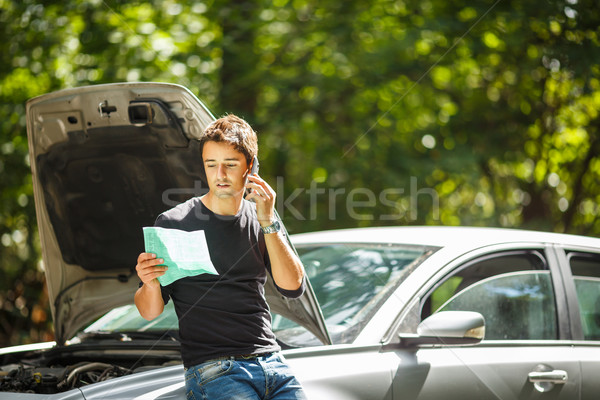 Handsome young man calling for assistance  Stock photo © lightpoet