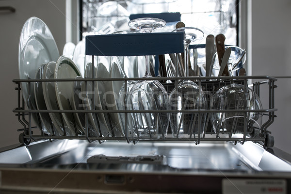 Open dishwasher with clean glass and dishes selective focus  Stock photo © lightpoet
