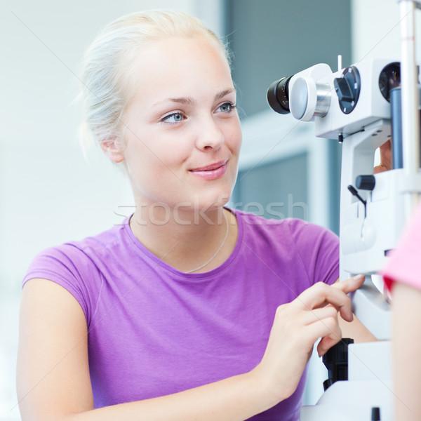 optometry concept - portrait of a young pretty optometrist using Stock photo © lightpoet