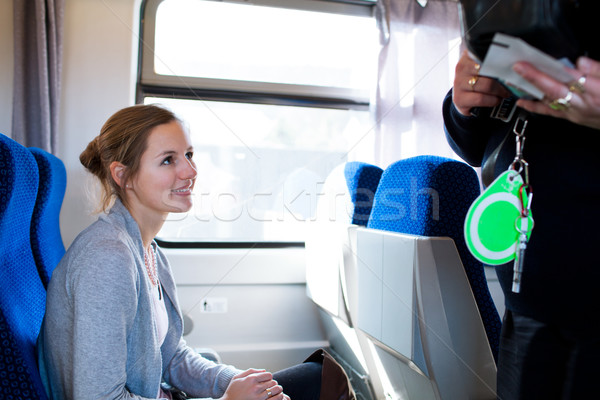 woman having her ticket checked by the train conductor Stock photo © lightpoet