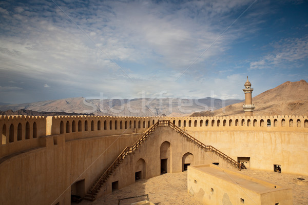 Stunning view of the Nizwa fort surrounded by mountains Stock photo © lightpoet
