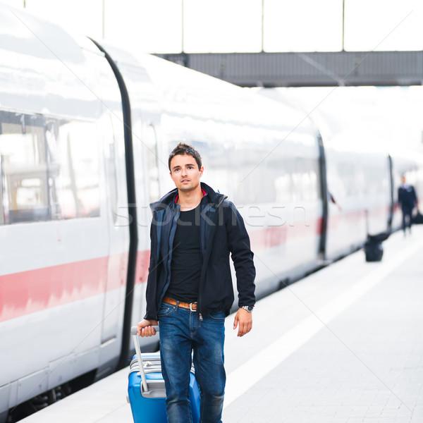 Just arrived: handsome young man walking along a platform at a m Stock photo © lightpoet