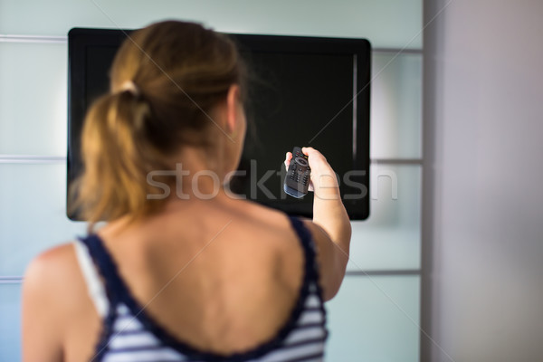 Young woman at home watching TV Stock photo © lightpoet