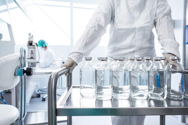 Flasks with liquids in a lab Stock photo © lightpoet