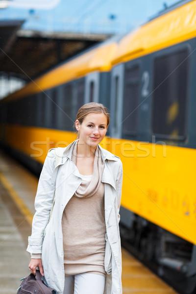 Csinos fiatal nő vasútállomás szín város vonat Stock fotó © lightpoet