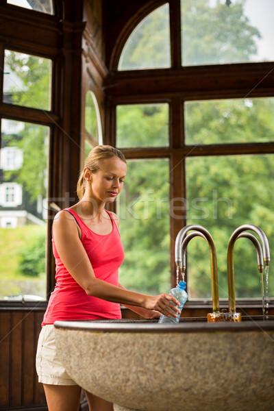 Fiatal nő műanyag üveg egészséges ásványvíz fürdő Stock fotó © lightpoet