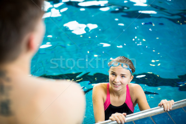 Female swimmer in an indoor swimming pool , talking to a friend  Stock photo © lightpoet