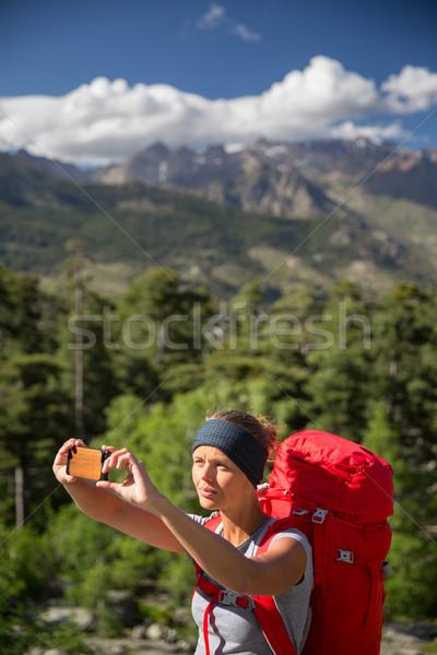 Pretty, young woman hiker taking a selfie photo  Stock photo © lightpoet