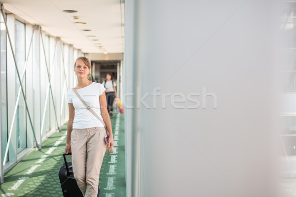 Portrait of a young woman in the boarding bridge Stock photo © lightpoet